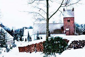 idyllic-village-with-snow-covered-church